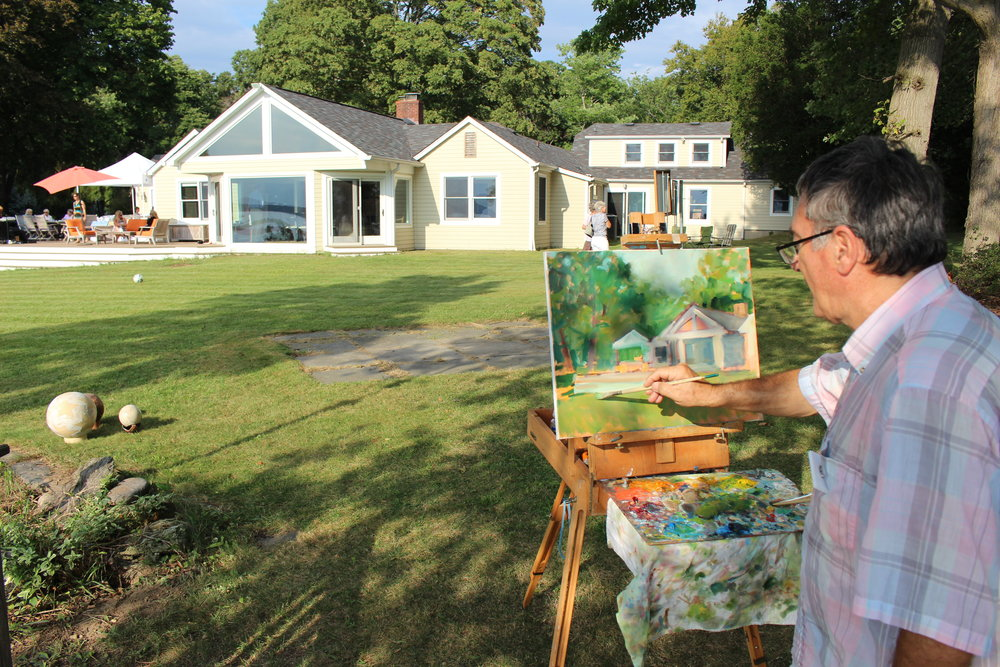 Long Islander News photos/Janee Law  Bart Deceglie, a teacher at Art League of Long Island in Dix Hills, is stationed with his easel on top of a bluff, overlooking the Northport Harbor, at the Firefly Artists' pop-up gallery event that was hosted over the weekend.