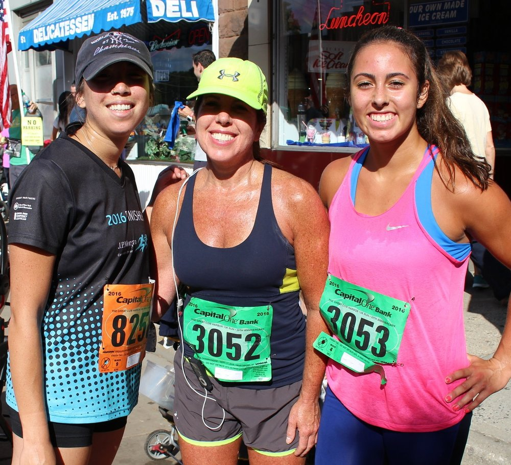 Long Islander News photos/Janee Law    Dana Liu, of Northport, and Barbara and Melissa Capri, both of East Northport, are pictured after participating in the 39th annual Great Cow Harbor 10K Race in Northport on Saturday.
