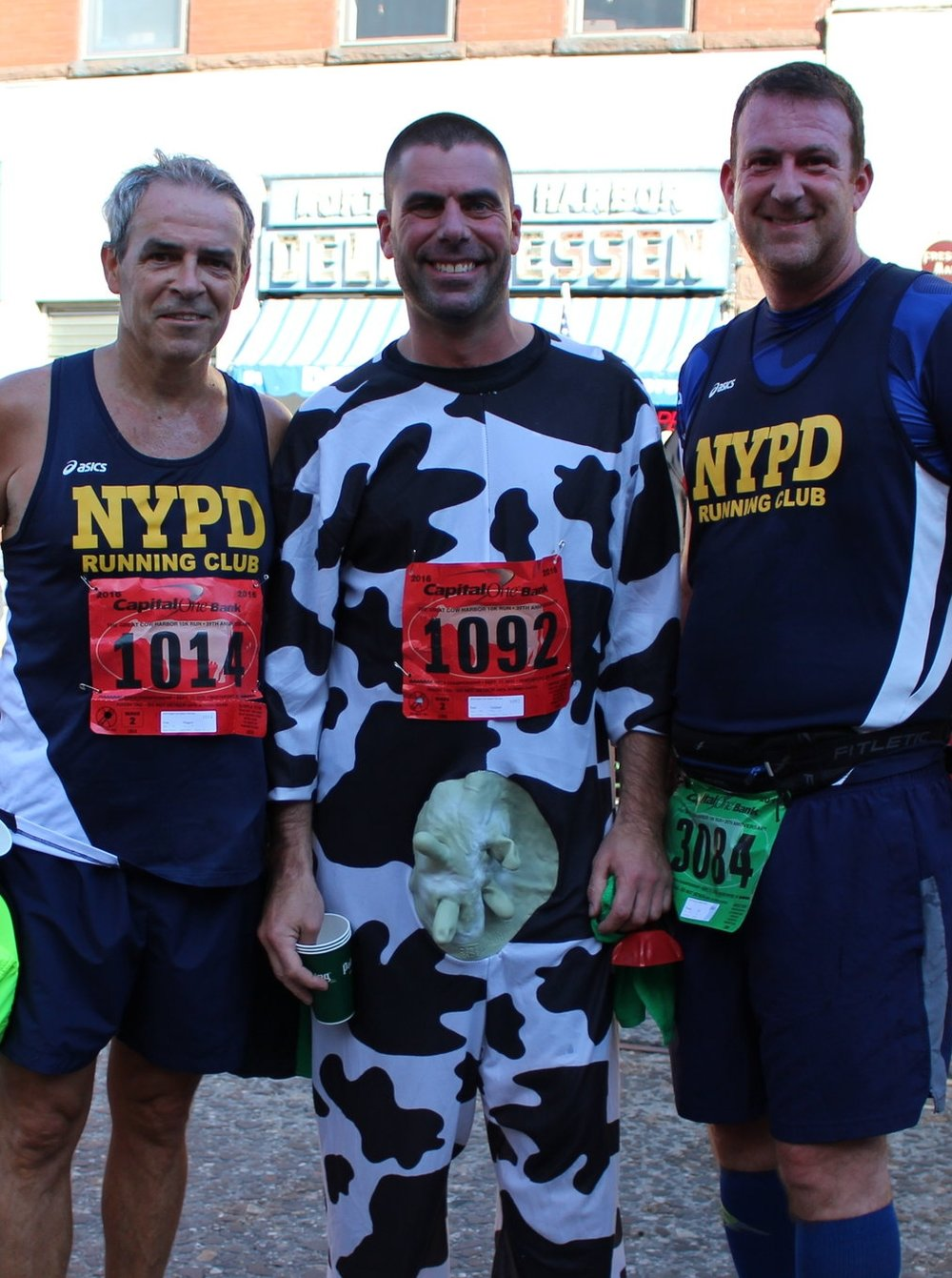 Long Islander News photo/Janee Law Tom Biggers, left, and Tommy Coll, right, both of Massapequa, have participated in the Great Cow Harbor Race four times, while Paul Giuliani, middle, of East Northport, has participated 16 times.