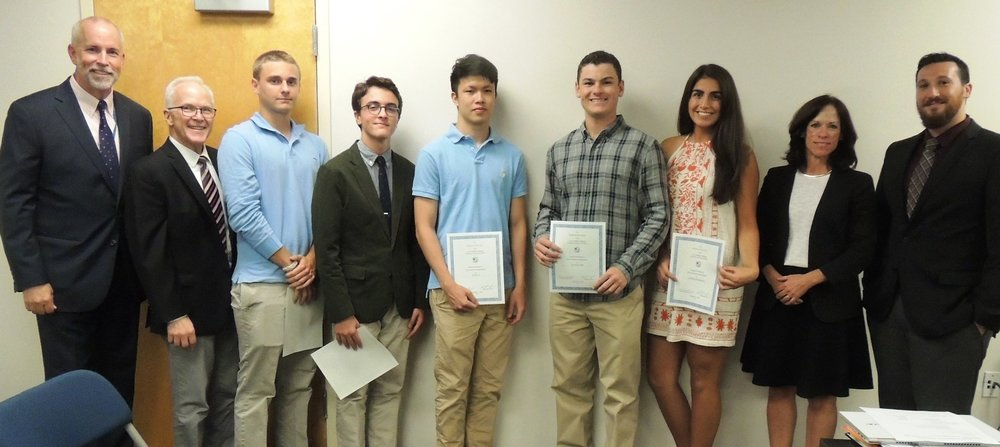Photo by Karen Spehler Cold Spring Harbor school board members honor five students who recently earned state honors in music. Pictured, from left: Robert Fenter, Cold Spring Harbor superintendent; Tim Jenks, music teacher; Ryan McLaughlin; Alec Israeli; Erwin Li; Harrison Cohen; Catherine Khanamirian; Amy Brogan, school board president; and Brent Chiarello, K-12 music chairperson.