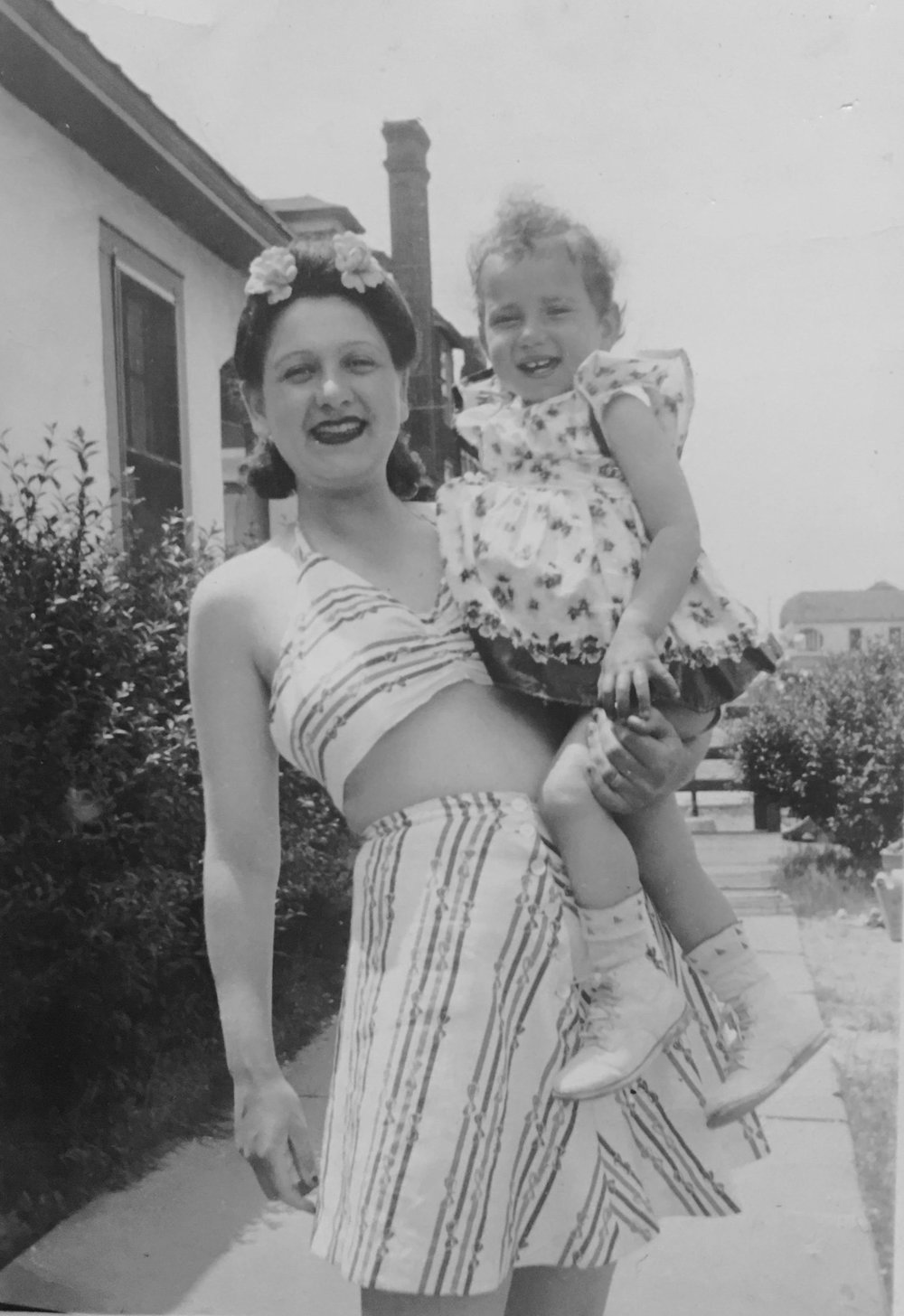 Photo courtesy of Phyllis Nicole Udinsky Beatrice Halperin, left, a Dix Hills resident who just celebrated her 100th birthday, holds her daughter, Phyllis Nicole Udinsky, at a beach in New York circa 1946.