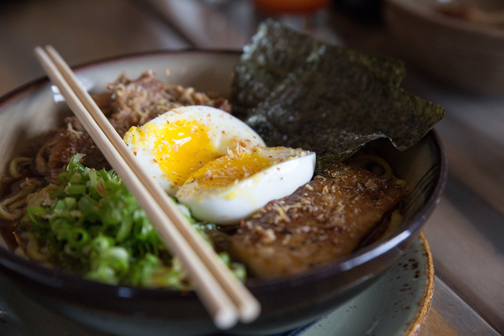 Long Islander News photos/Craig D'Andrea The Ramen at True North is deliciously brewed with pork belly, pork shoulder, soft boiled egg and crispy ginger. It was the result of Chef Paul Miranda's quest to find the best ramen bowls in Chinatown.