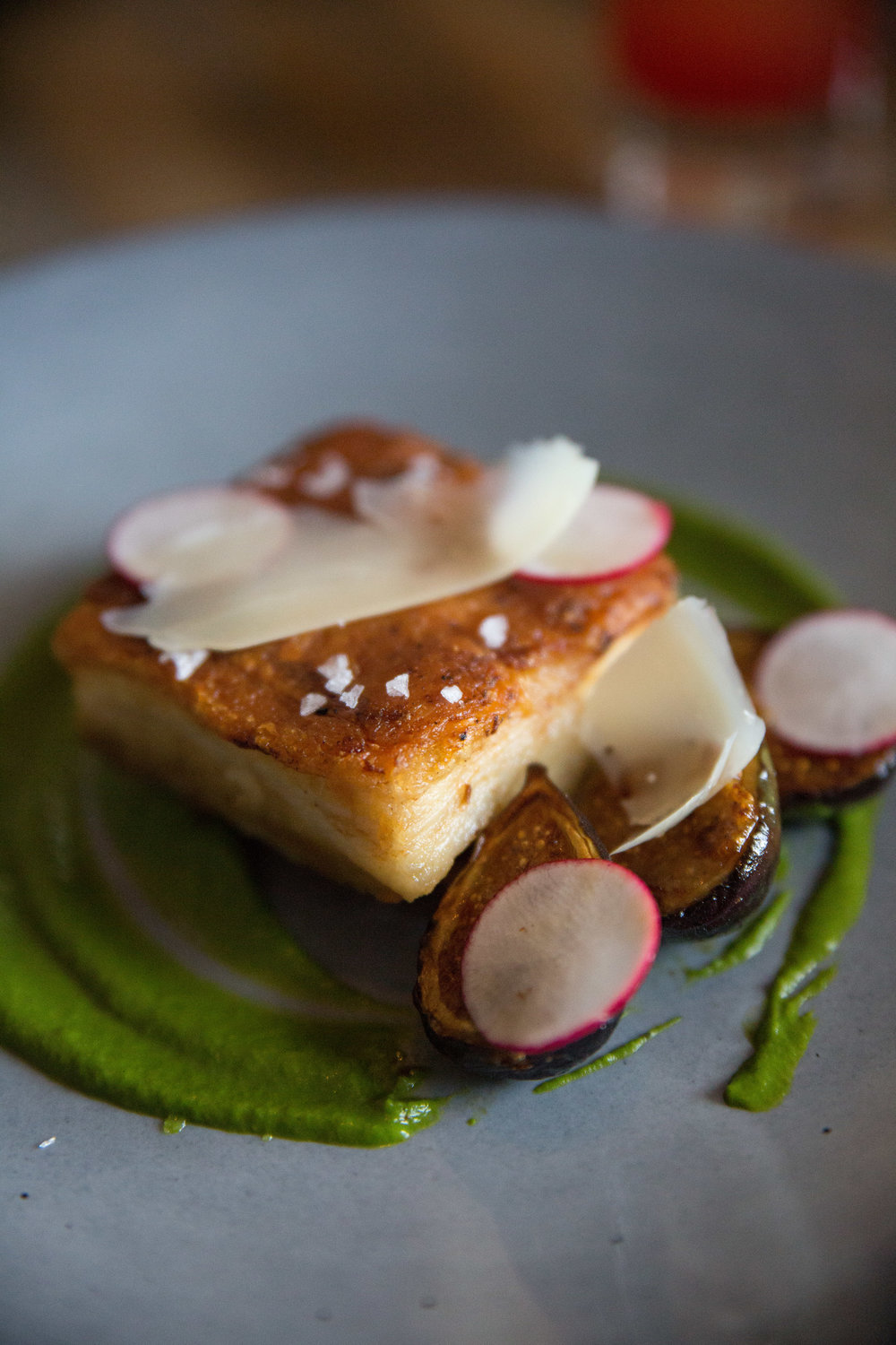 Long Islander News photos/Craig D'Andrea       The Olive Oil Braised Pork Belly was a decadent, yet balanced treat, served alongside warm roasted black mission figs, aged provolone, broccoli rabe and pink peppercorn honey.
