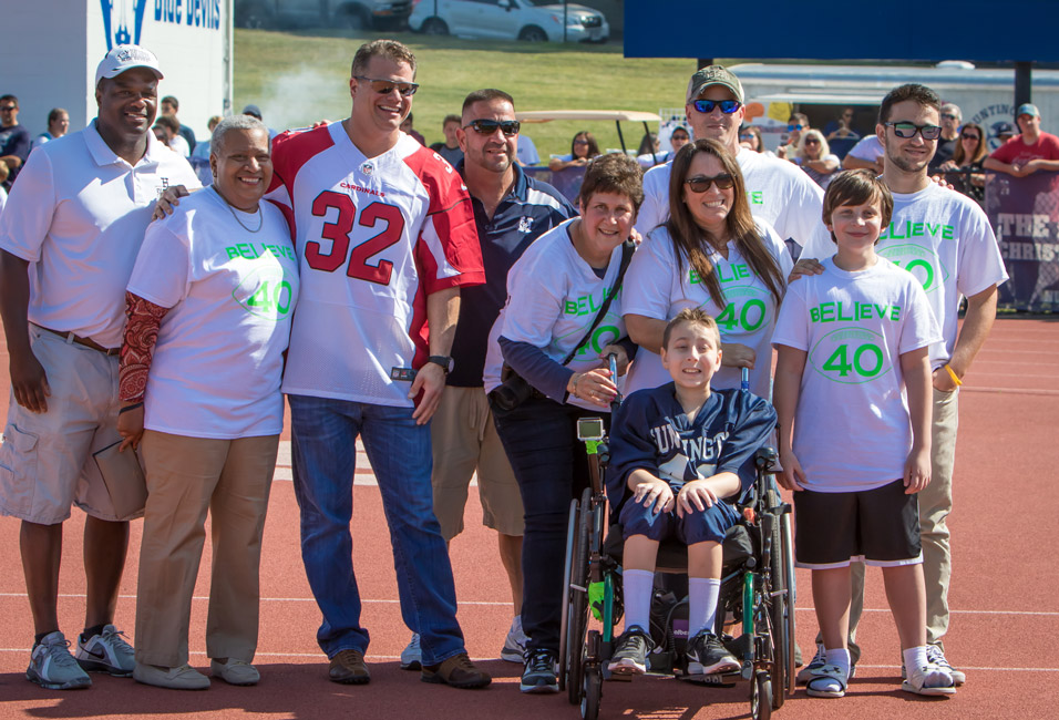 Photo by Mike Connell   Eli Mollineaux, seated, has extremely rare mitochondrial condition Pearson's Syndrome. On Saturday, the sophomore suited up alongside the Blue Devils football team and scored a 50-yard touchdown on an exhibition play in the third quarter.
