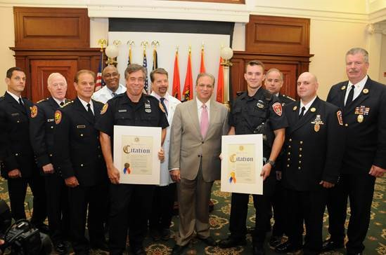 Photo/Nassau County Pictured, from left: Fourth Precinct Commanding Officer Lee Steinberg, Nassau Chief of Patrol Frank Kirby, Nassau Police Chief of Department Steven Skrynecki, Dr. Anthony Boutin, NUMC chair of the emergency department, Nassau Police Officer Gary Boulanger, NUMC President and CEO Dr. Victor Politi, Nassau Executive Edward Mangano, Freeport Police Officer Corey Cooke, Freeport Chief of Police Miguel Bermudez, Freeport Fire Chief Matthew Colgan and Freeport Fire Department Executive Director Raymond McGuire.