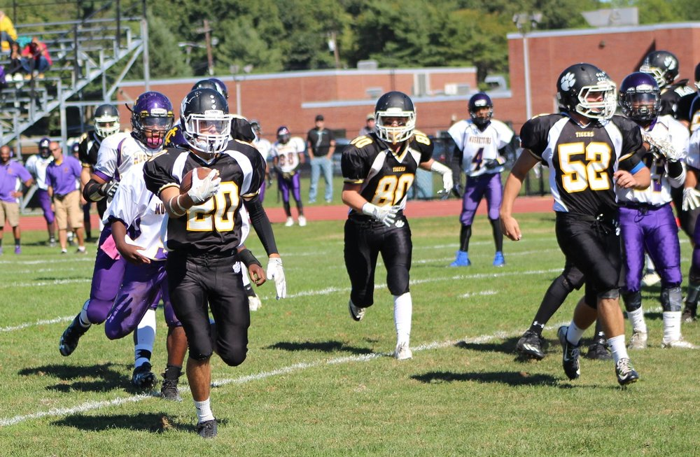 Long Islander News photo/Janee Law Junior Sean Eagers (no. 20) runs for a 4-yard touchdown in Northport's homecoming game against Central Islip on Saturday.