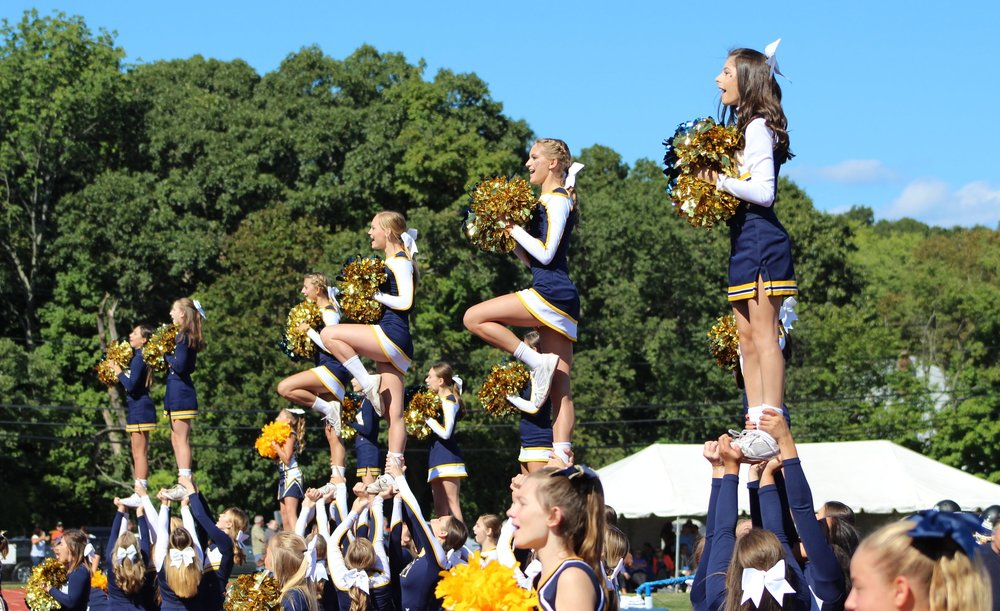 Long Islander News photo/Janee Law The Northport Cheerleading team performs a variety of stunts for the crowd at the Northport homecoming game on Saturday.