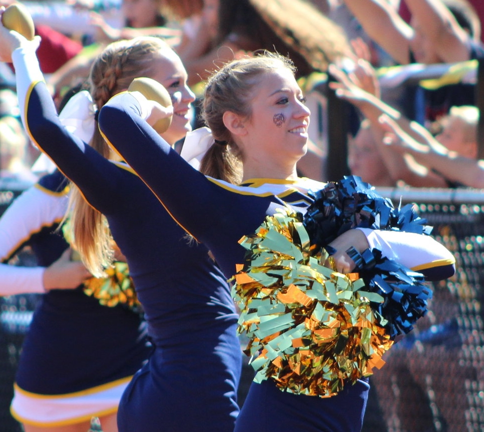 Long Islander News photo/Janee Law At the Northport homecoming game on Saturday, the varsity cheerleading team excites the crowd by throwing mini footballs into the stands.