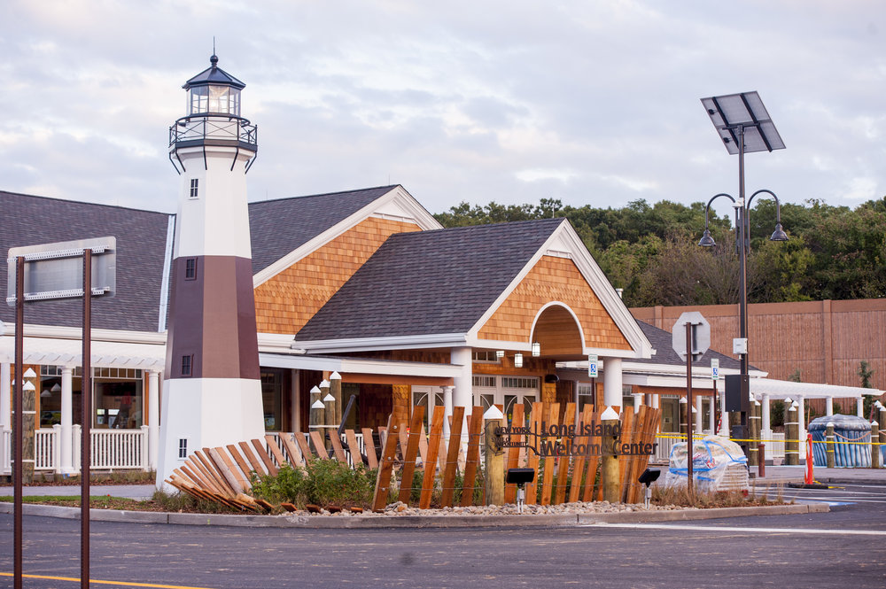 "State DOT spokesman Gary Holmes called the Long Island Welcome Center's design ""regionally inspired,"" featuring a replica lighthouse, as well as net buoys adorning the side of the 15,200-square-foot building."