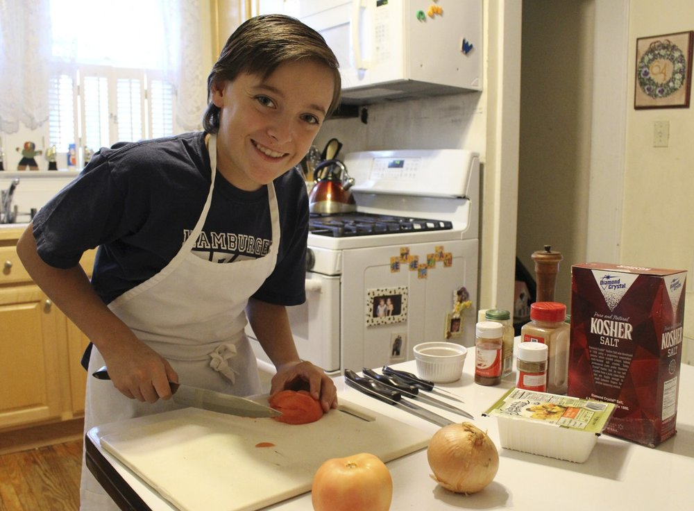 "Long Islander News photos/Janee Law Thirteen-year-old William Connor, pictured in the kitchen of his Northport home, is a talented chef. He's set to compete in an episode of the Food Network's ""Chopped Junior"" that's slated to air Oct. 25."