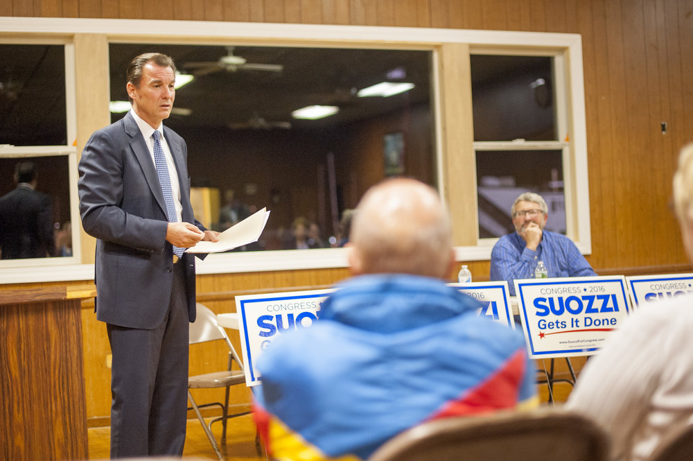 Long Islander News photo/Jano Tantongco Thomas Suozzi, Democratic candidate for the 3rd Congressional District, discusses immigration policy with his potential constituents at a town hall meeting he hosted at the American Legion Post 360 in Huntington last Thursday.