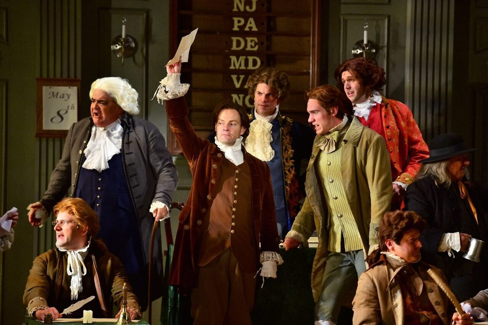 Photos by Michael DeCristofaro Pictured from left: Adam Mosebach (as Charles Thomson), Stephen Valenti (as Lewis Morris), Jamie LaVerdiere (as John Adams), Tom Lucca (as John Hancock), Michael Glavan (as Thomas Jefferson), Jon Reinhold (as Richard Henry Lee), Benjamin Howes (as John Dickinson) and Robert Budnick (as Stephen Hopkins).