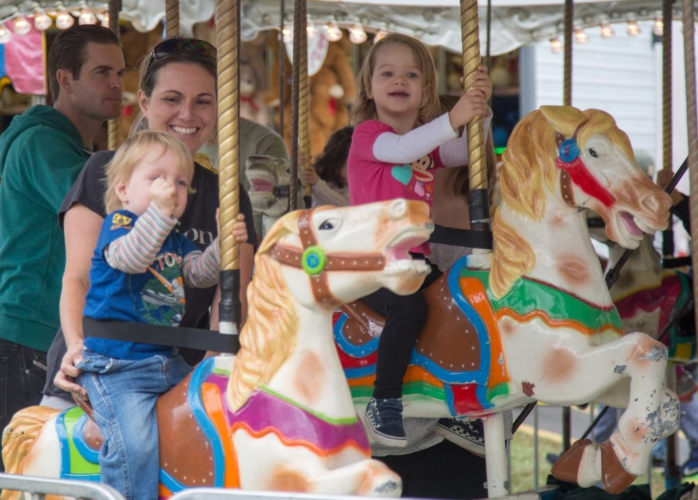 Photo by Bryan Sansivero The merry-go-round at the festival brought out plenty of smiling faces