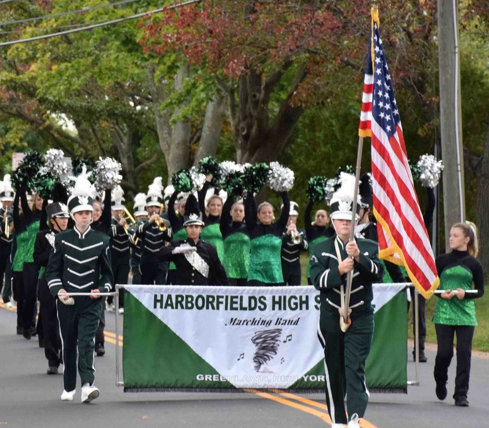 Photos courtesy of the Harborfields School District The Harborfields marching band makes its way down the street during the district's annual homecoming parade.