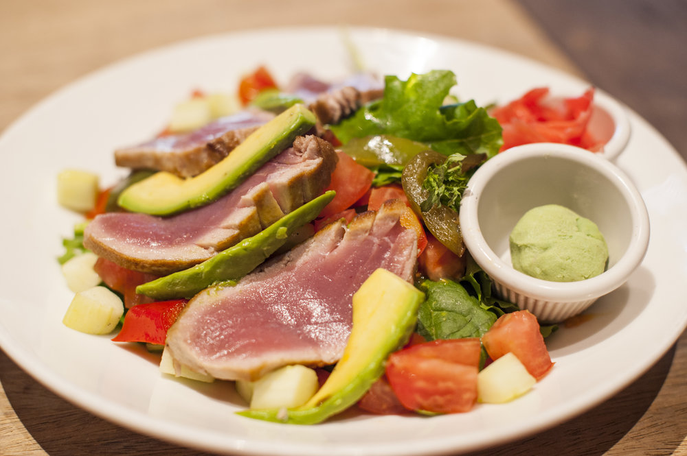 The Ahi Tuna Salad at Mac's is hearty, yet light, composing together mixed greens, tomatoes, sliced avocado, mixed peppers and cucumbers topped with white balsamic vinaigrette.