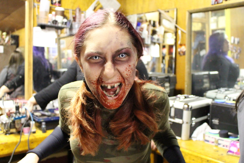 Lauren DeLorenzo, of Hicksville, preps for her role as cannibalistic hillbilly 'Lou-Ann' in the Haunted Mansion of Melville, which is located at F&W Schmitt's Family Farm.