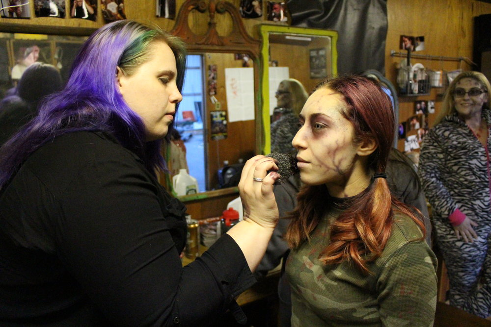 The Haunted Mansion of Melville's makeup artist Lauren Budd, of Northport, applying fake blood to Lauren DeLorenzo, of Hicksville, who plays cannibalistic hillbilly Lou-Ann.