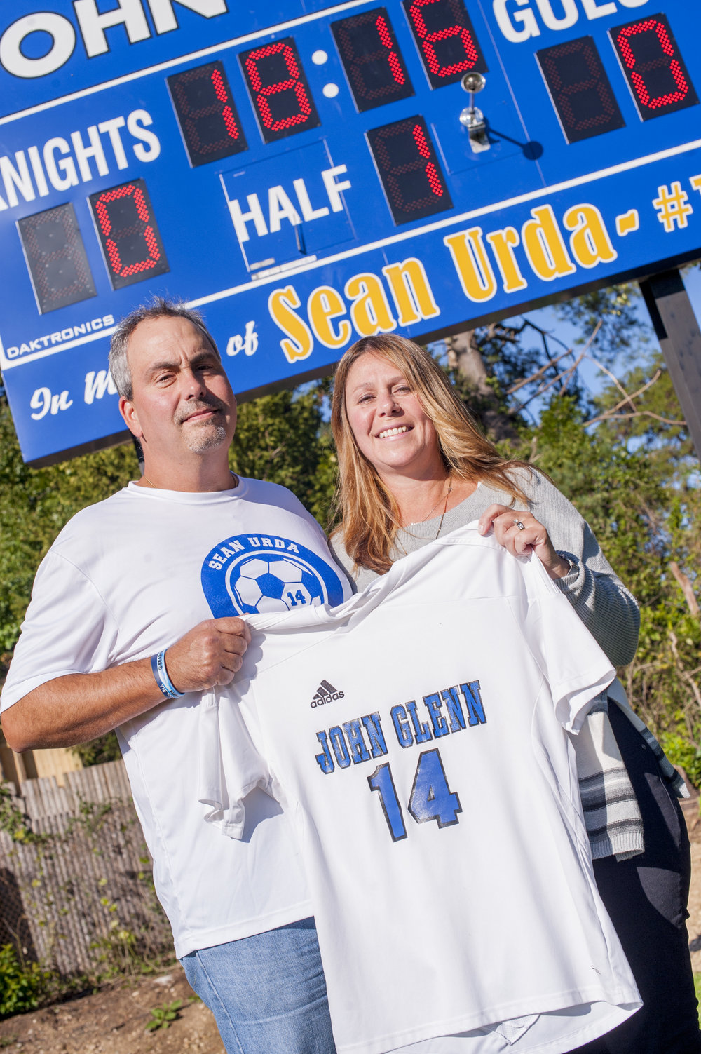 Nicole and Gary Urda, parents of the late Sean Urda, hold a no. 14 jersey. Sean, who was killed in a snow tubing accident last year, wore no. 14 when he played on Elwood-John Glenn's boys soccer team.