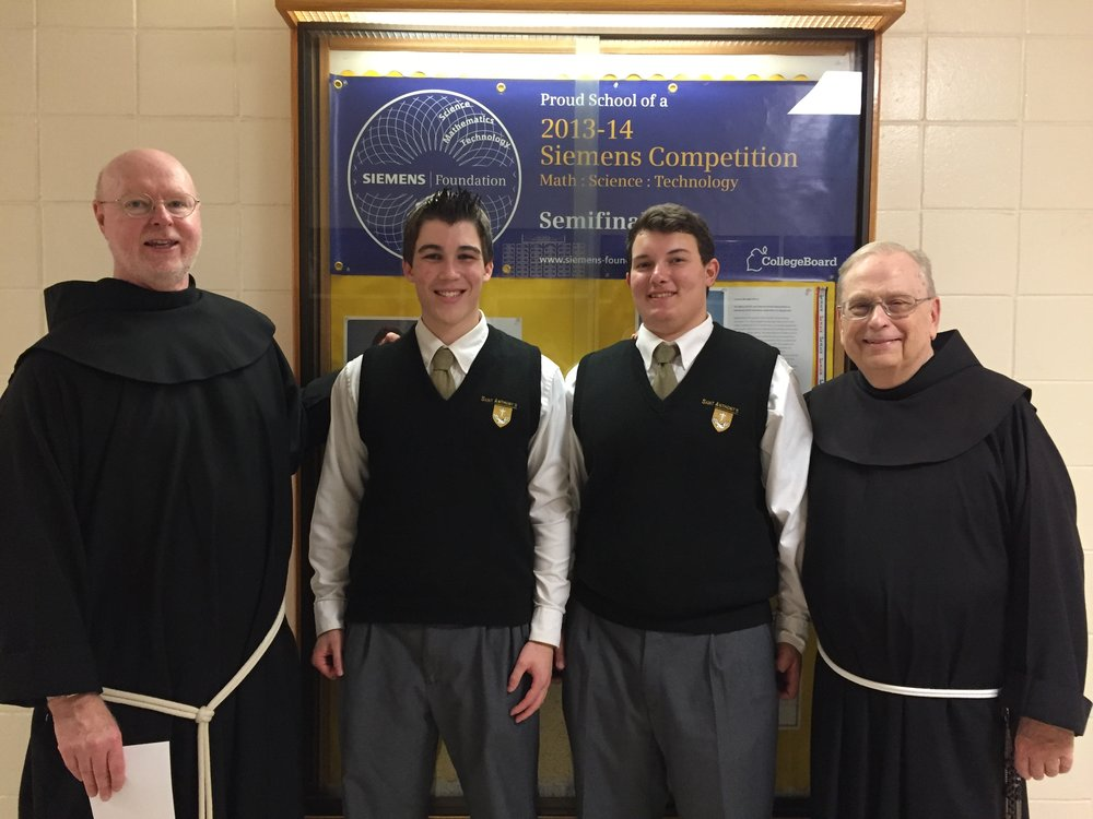 Photo courtesy of St. Anthony's High School     Semifinalists in the 2016 Siemens Competition Christopher Koch, left-center, and Nicholas DeFrancisco, right-center, stand in front of the banner that St. Anthony's High School received for its last semifinalist in the competition, Taylor Brown. The students are pictured with Principal Bro. Gary Cregan, left, and Academic Dean Bro. Robert Gabriel.