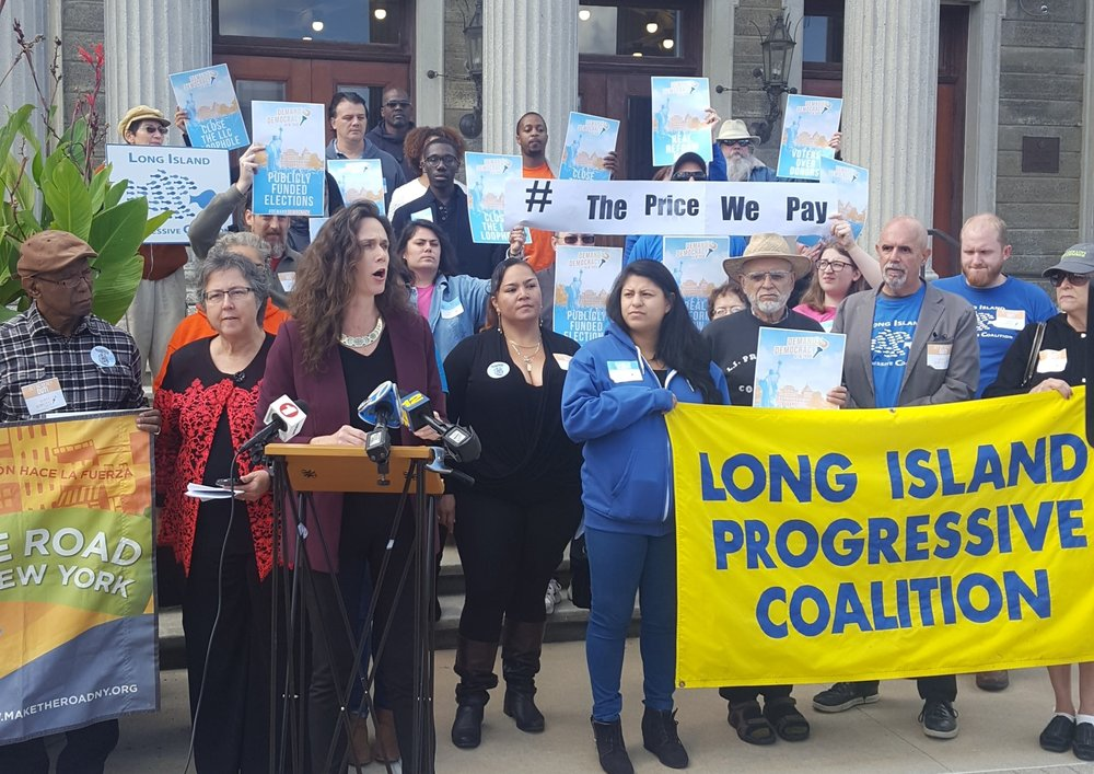 "Long Island Progressive Coalition Director Lisa Tyson calls for state legislators to ""stand up to corruption and restore the confidence of the residents of Long Island"" on Monday, less than a week after Nassau Executive Edward Mangano and Town of Oyster Bay Supervisor John Venditto were indicted on federal corruption charges."