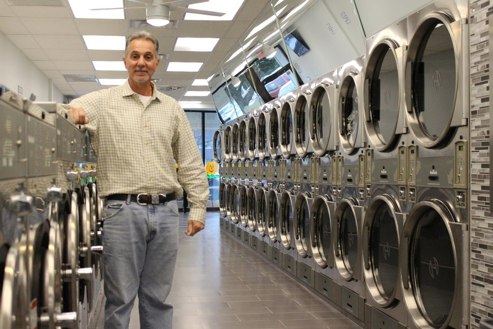 Craig DelloIacono, co-owner of Huntington Village Laundromat, took over the 2,300-square-foot location at 28 New St. in July.