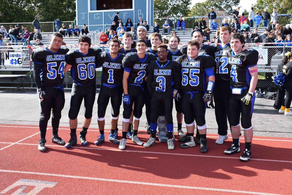 Knights seniors proudly pose right before their game against Bishop McGann-Mercy High School.