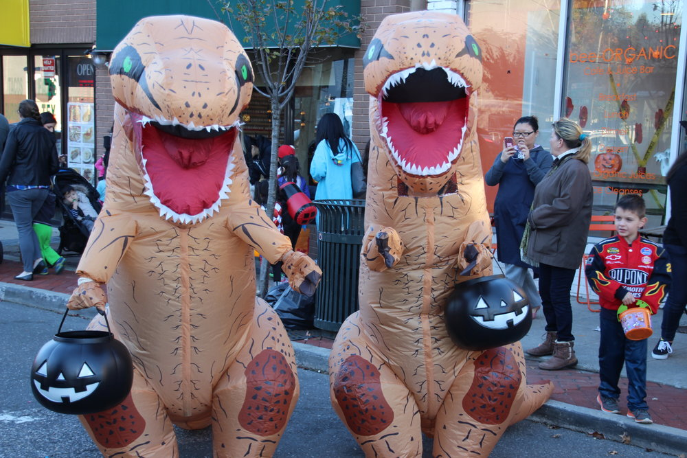 At times, Huntington village was transported back to the Cretaceous period, with costumed Tyrannosaurus Rex roaming the streets in search of candy.