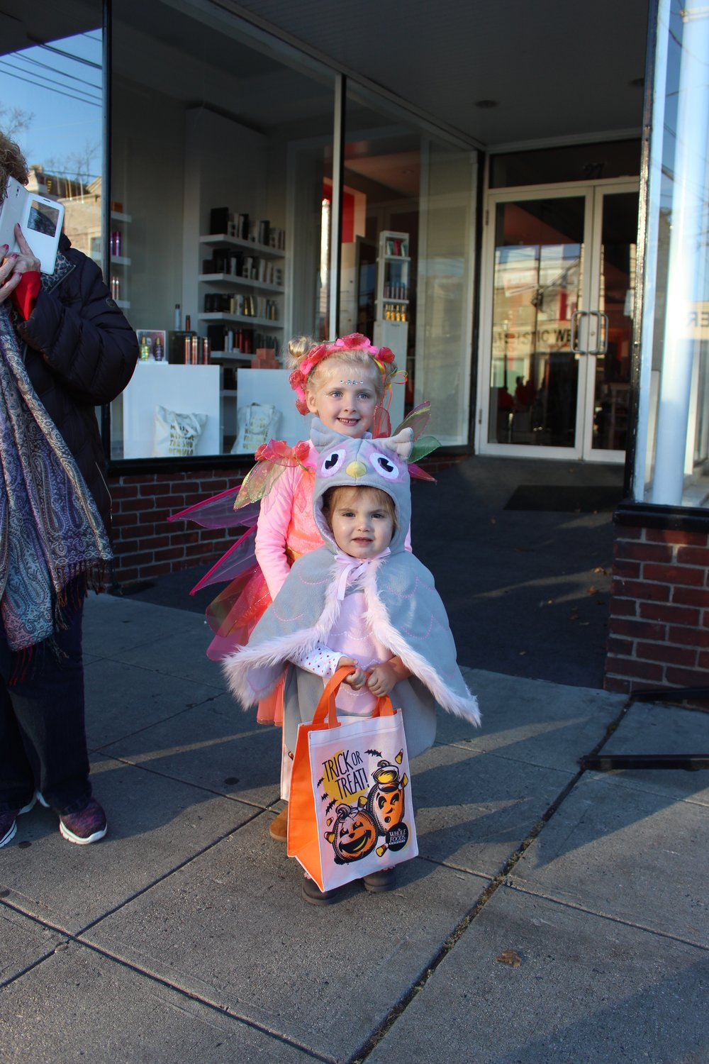 Huntington's Olivia, 5, dressed as a fairy, while Addie, 2, dressed as an owl for the annual Children's Halloween Costume Parade.