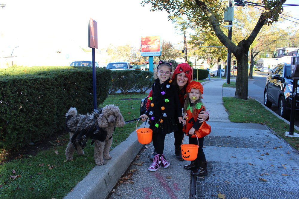 Irane, Viviana and Valentina Sardou, all of Huntington, are joined by their dog, Bruno.