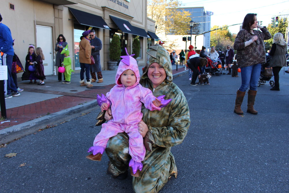 Leila, 15 months old, and Meghan Lacourte, both of Huntington, dress in dinosaur costumes.