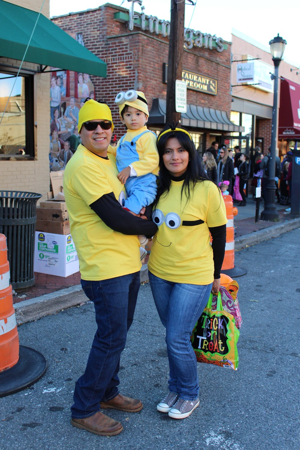Isaias, Christine and Janet Martinez dress as a family of minions.