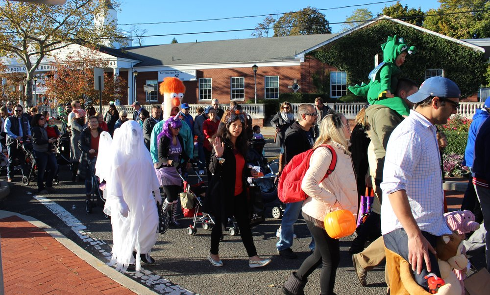 Families dressed in their favorite Halloween costumes march through Huntington village on Monday as part of the town's annual Children's Halloween Costume Parade.