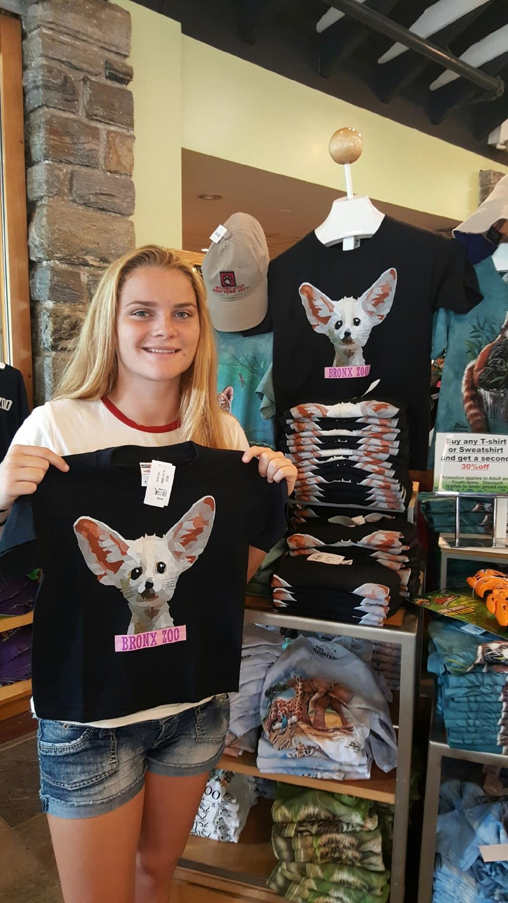 Harborfields High School senior Katelyn Maher took her passion for graphic design to the next level, with her t-shirts being sold at the Bronx Zoo and Central Park Zoo. (Photo / Harborfields School District).