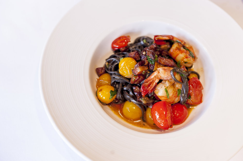 The Linguini Neri is a medley of shrimp, squid ink linguini, pancetta and red and yellow grape tomatoes, which burst with a fresh zest.
