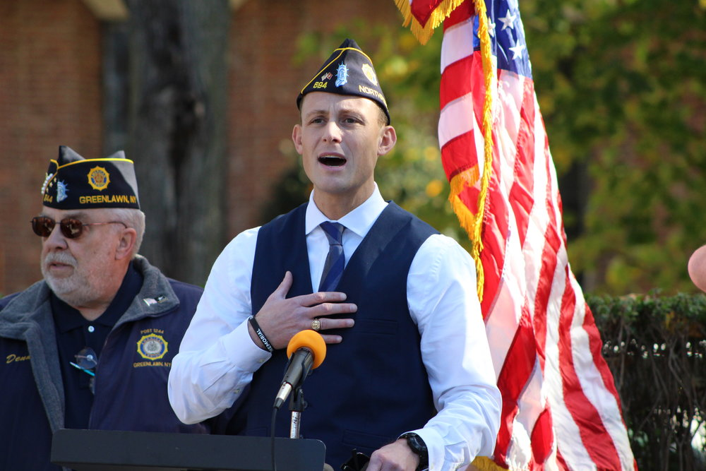 Afghanistan combat veteran Darryl St. George, president of the Greenlawn Civic Association and history teacher at Northport High School, speaks at the annual Veterans Day ceremony Friday, hosted by the American Legion Greenlawn Post 1244.