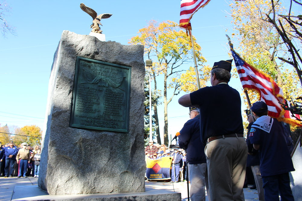 Dozens gather at Greenlawn Memorial Park to honor veterans on Friday.