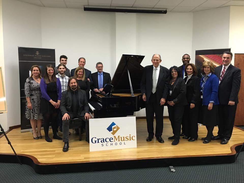"Owners, officials and students of Grace Music School's Melville location – found within the Steinway and Sons-owned showroom – announced the school's first piano competition last weekend. The competition will feature classical works from Billy Joel's ""Fantasies and Delusions."" (Photo / Facebook)."
