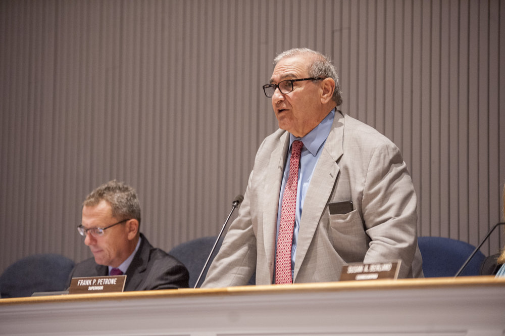 Huntington Supervisor Frank Petrone addresses attendees of the Sept. 27 town board meeting, during which the board approved piercing the town's state-mandated tax cap for its 2017 operating budget.