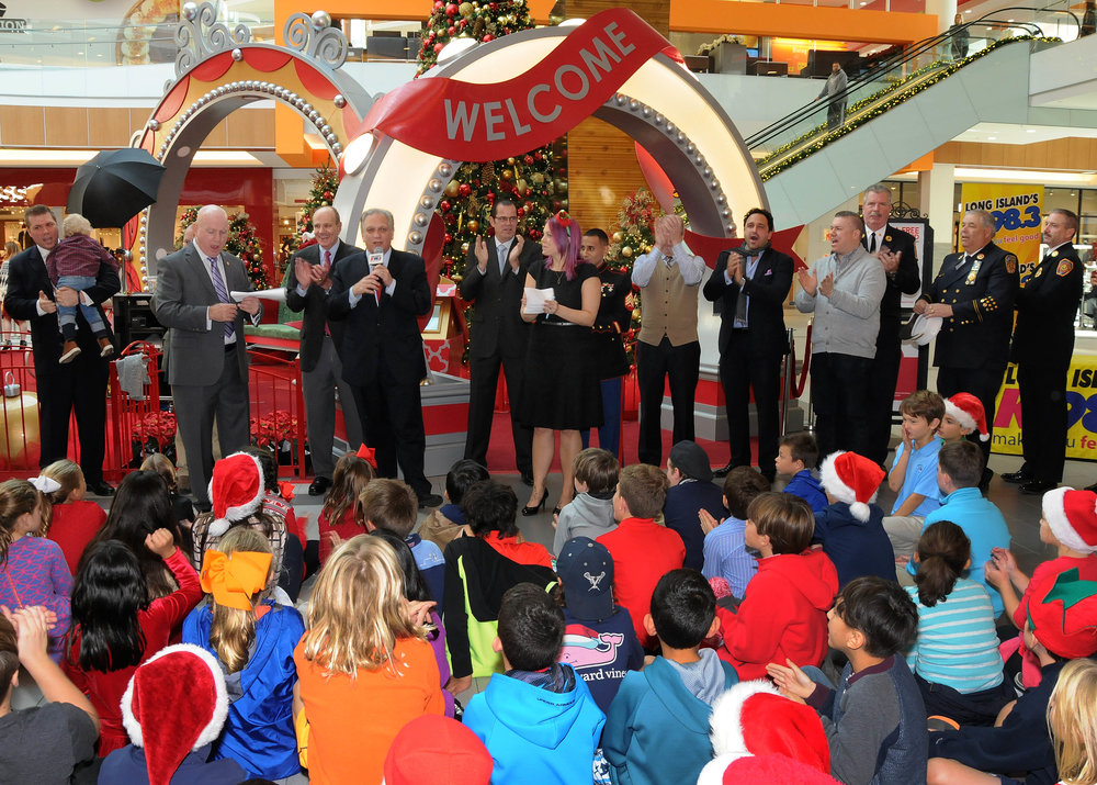 Students of Garden City's Stewart and Stratford elementary schools present toys to the U.S. Marine Corps for their Toys for Tots Drive at the Roosevelt Field Mall.