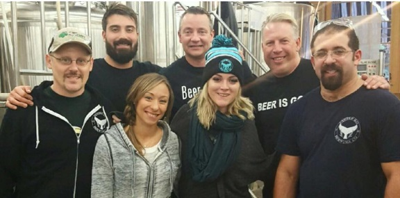 Tim Kelly, of East Northport's Lark Pub And Grub, is pictured with the team at Oyster Bay Brewing Company, where a solid Red IPA was recently brewed for the Lark.