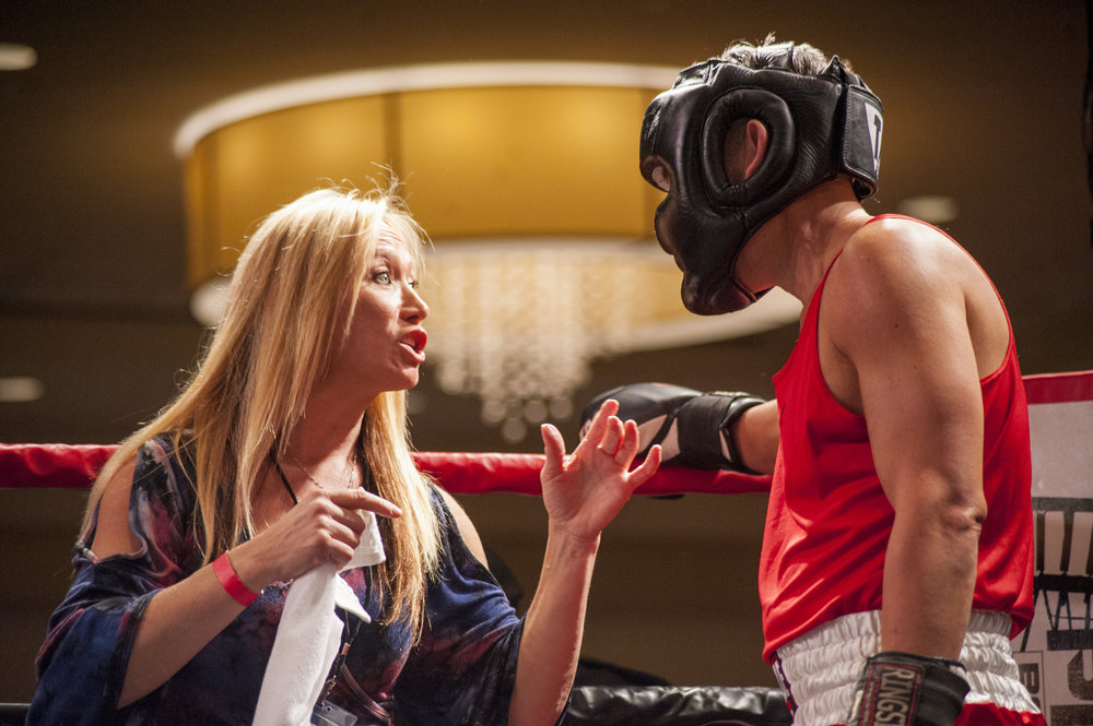 """Joanne Hutchins, left, a Fight For Charity organizer and Long Islander News sales associate, gives boxer Scott """"The Gubes"""" Guber, of Dix Hills, some tips in between matches."""