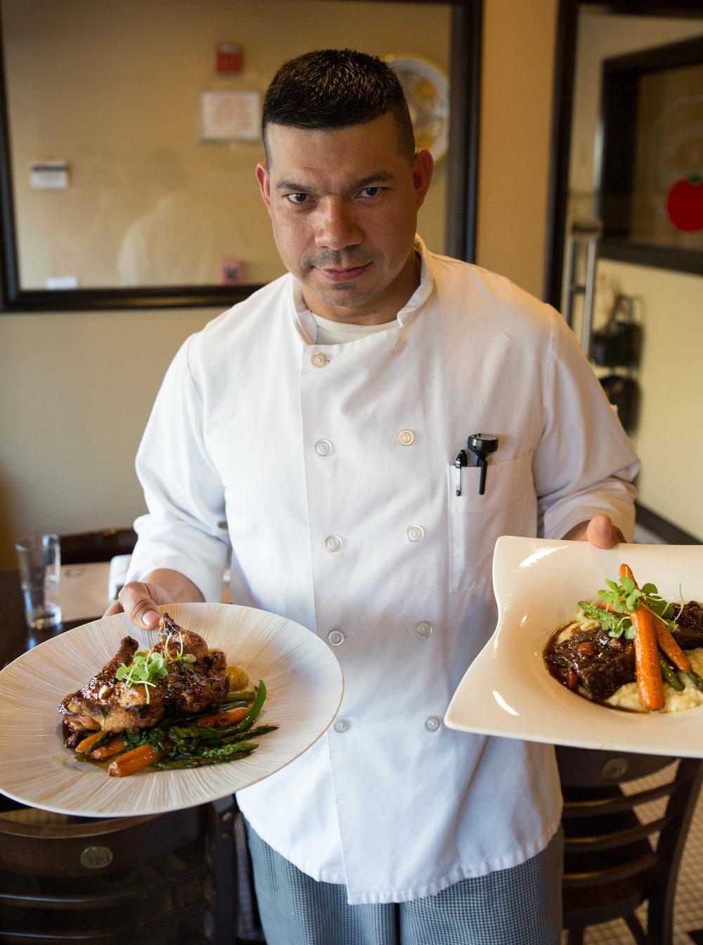 Chef Elmer Veraccio shows off two enticing entrees, the Pollo Alla Diavola and the Brasato Al Barolo.