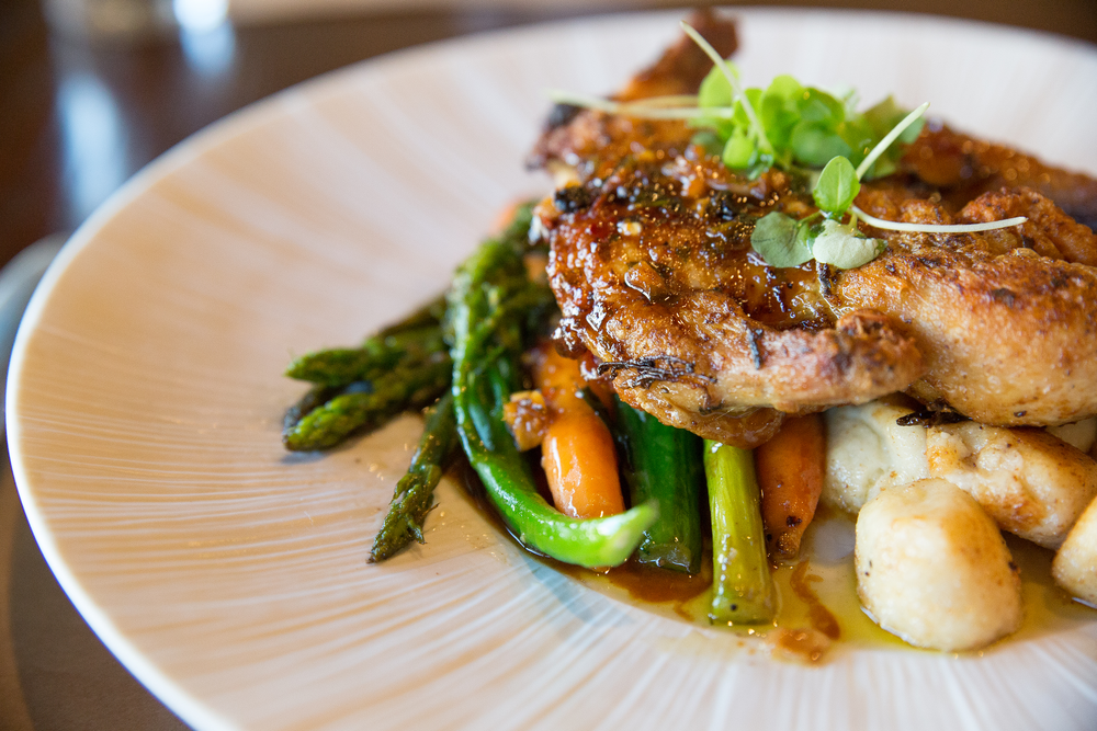 The Pollo Alla Diavola plates a roasted marinated chicken, seasonal vegetables, fried gnocchi drizzled with a savory rosemary pan jus.