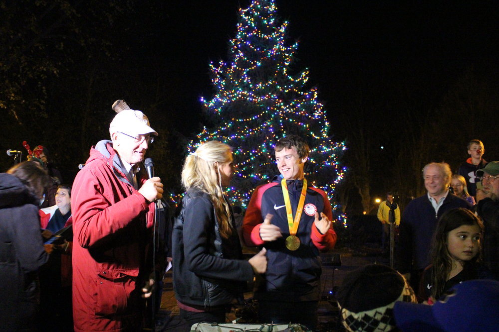 U.S. women's soccer Olympian Allie Long and U.S. track and field Paralympian Michael Brannigan are all smiles after flipping the switch to light the Northport Village Christmas tree.