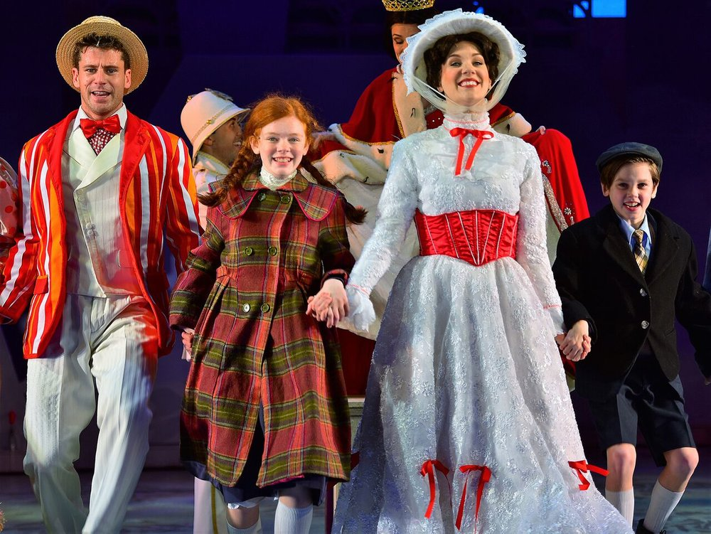 "Luke Hawkins (as Bert), Katherine LaFountain (as Jane Banks), Analisa Leaming (as Mary Poppins), and Christopher McKenna (as Michael Banks) performing ""Jolly Holiday"" at the John W. Engeman's production of ""Mary Poppins."" (Photo by Michael DeCristofaro)."