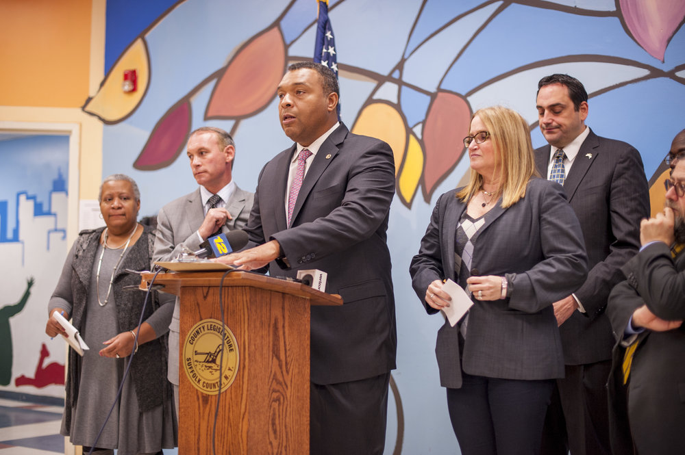 "Suffolk Legislator William ""Doc"" Spencer speaks last week at a conference that brought together educational, religious and community leaders to jointly denounce an apparent uptick in local hate incidents."