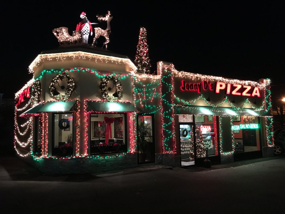 Jonny D's Pizza shines bright in Huntington Station thanks to some newly-affixed holiday lighting and decorations.