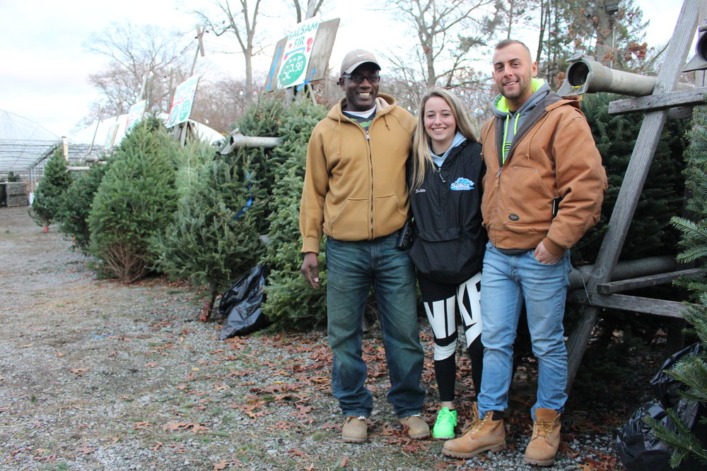 Prianti Farms co-owners Andrew Daniel, Gianna DiLillo and Giro DiLillo Jr., are the smiling faces that welcome customers seeking holiday decorations at the Dix Hills farm.