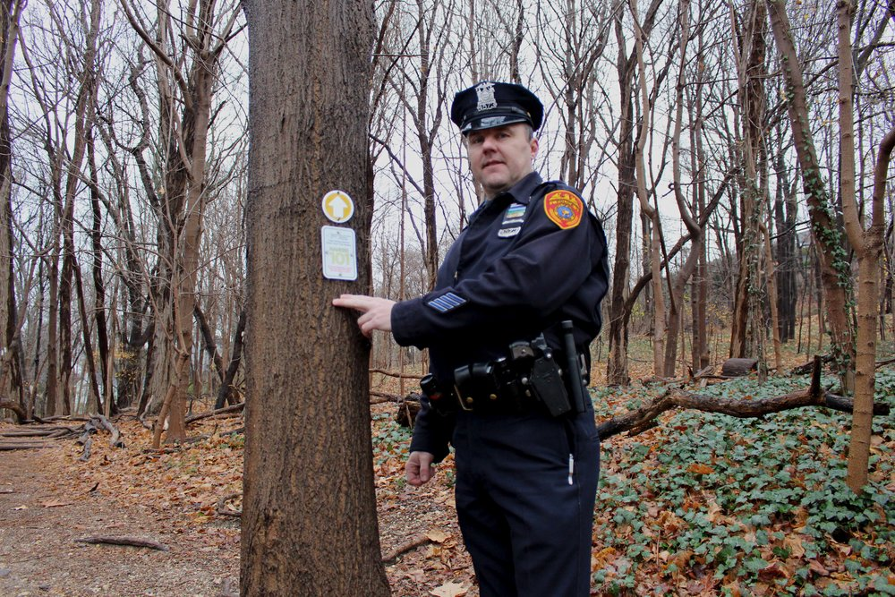 James Garside, a Suffolk police officer in Second Precinct, spearheaded an initiative to install trail markers along the path in Cold Spring Harbor State Park to help emergency response teams quickly locate injured hikers.