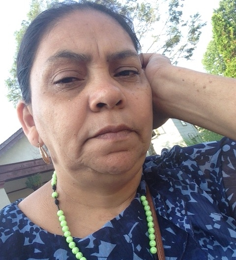 Ena Flores, a 47-year-old Huntington Station woman, was killed Sunday after being struck by an unlicensed driver on New York Avenue.